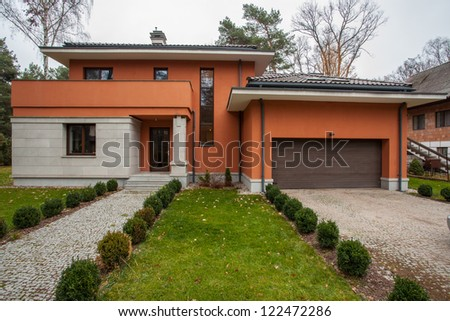 Travertine house - facade of modern house, horizontal view - stock photo