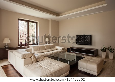Travertine house: Soft and comfortable sofa in living room - stock photo
