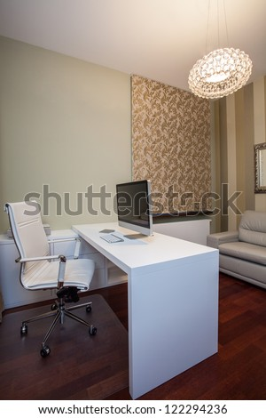 Travertine house - vertical view of a home office - stock photo