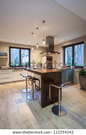 Travertine house - vertical view of a kitchen - stock photo
