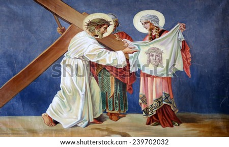 TRAVNIK, BOSNIA AND HERZEGOVINA - JUNE 11: 6th Stations of the Cross, Veronica wipes the face of Jesus  in the Church of St. Aloysius in in Travnik, Bosnia and Herzegovina on June 11, 2014. - stock photo
