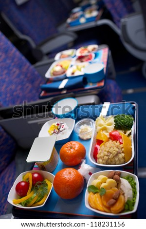 Tray of food on the plane, business class travel - stock photo