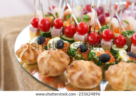 tray with canape at buffet - stock photo