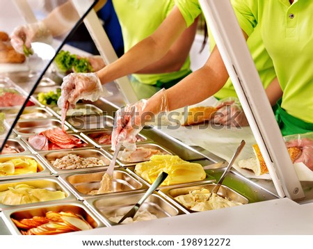 Tray with cooked food on showcase at cafeteria. - stock photo