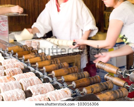 Trdelnik also known as Trdlo is a czech traditional sweet pastry ; taken   during baking and cooking. - stock photo