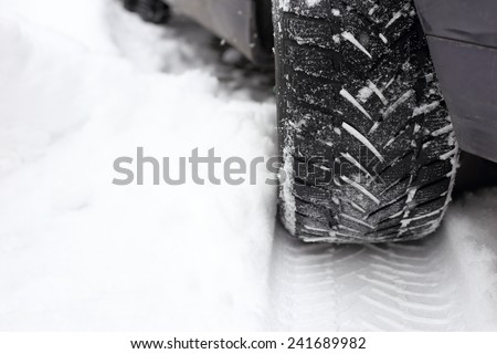 tread in the snow from car tire - stock photo