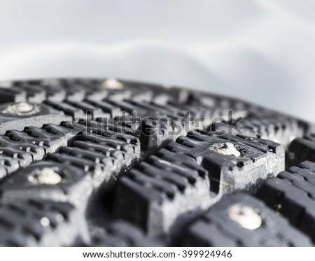 Tread winter car tire close-up - stock photo