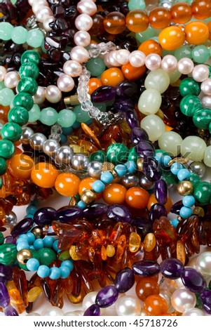 Treasure chest, a mass of colorful necklaces and bracelets - stock photo