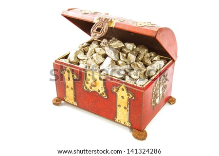 Treasure-chest filled with golden stones isolated over white