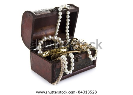 Treasure Chest full of jewelery  isolated over white background - stock photo