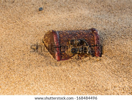 Treasure chest  on the beach, on a background of sand  - stock photo