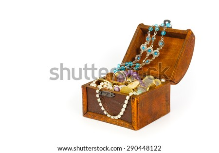 Treasure chest with bracelets, coins, rings and pearls isolated on white background - stock photo