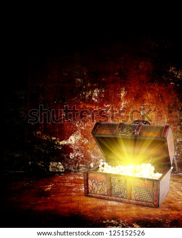 treasure chest with jewelry inside against grunge background - stock photo