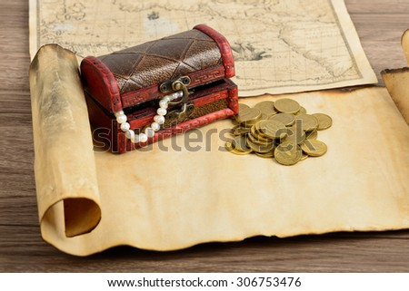 Treasure map, chest and coins - stock photo