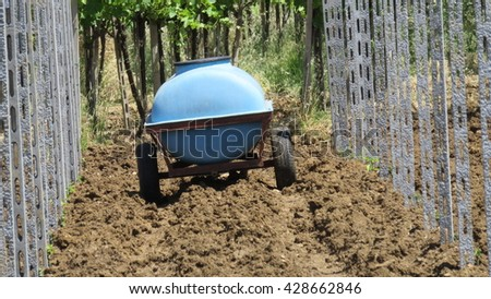 treatment in the vineyard pesticides - stock photo