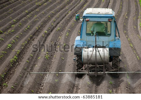 Treatment of crops against weeds - stock photo
