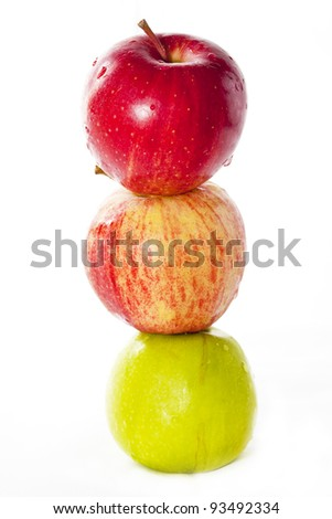 Tree apples in vertical row. Isolated on white. - stock photo