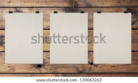 tree blank poster on a wood wall - stock photo