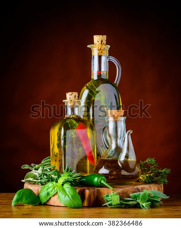 tree Bottles of extra virgin olive oil with pepper greef food herbs and rosemary