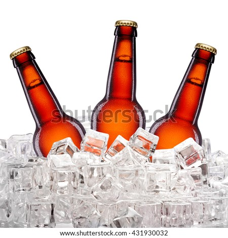 Tree brown bottles of beer in ice cubes  isolated on white background