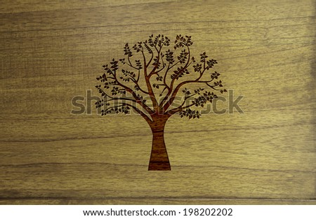 Tree graphic on wood texture.