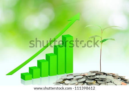 Tree growing on money with green graph - stock photo