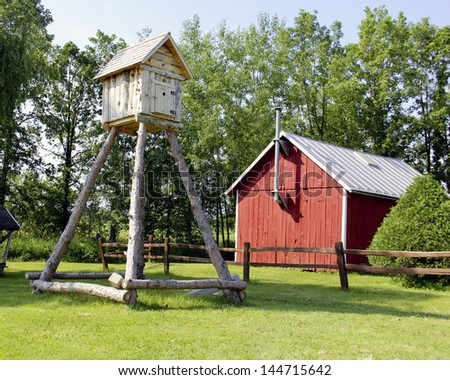 tree house and country cabin in a rural setting with grass and trees in the background - stock photo