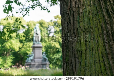 Tree in front of Statue of Swedish botanist and biologist Carl Linnaeus, Stockholm, Sweden.
