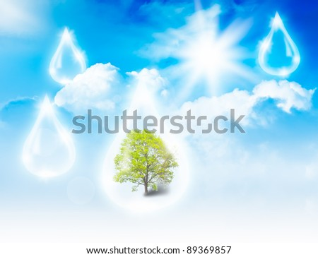 Tree in water drop on sky background. Eco concept - stock photo