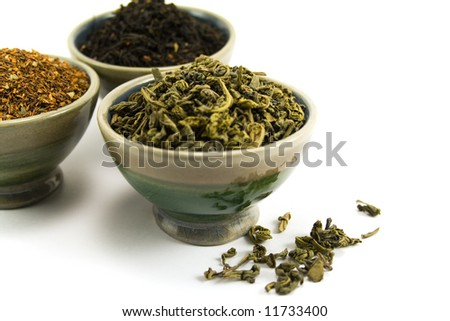 tree kinds of tea in bowls on white background - stock photo