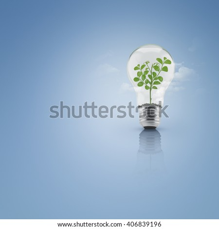 Tree leaves growing inside light bulb with soil over cloud and blue background, Green eco energy concept