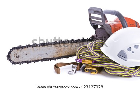 tree surgeon tools including chainsaw, helmet, harness and rope on white landscape