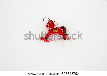Tree toy Red horse on the snow in the New Year and Christmas