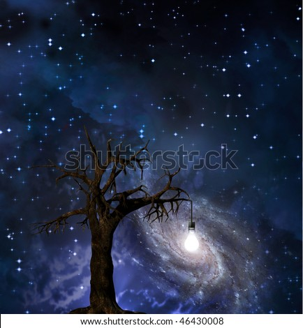 Tree with hanging light bulb and galaxy in starscape - stock photo