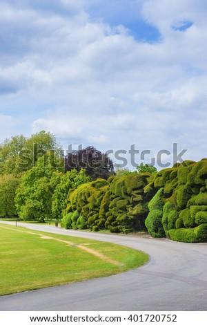 Trees and bushes in  Audley End House in Essex in England. It is a medieval county house. Now it is under protection of the English Heritage. - stock photo