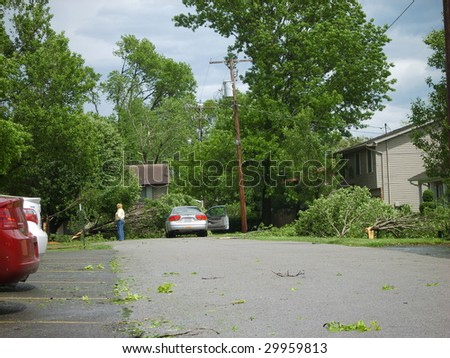 Trees blocking this street as a result of the derecho May 8, 2009 in Marion, IL. - stock photo