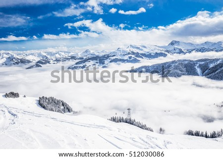 Trees covered by fresh snow in Austria Alps from Kitzbuhel ski resort - one of the best ski resort in the workd with 54 cable cars, 170 km prepared skiing slopes and place of famous hahnenkamm races.