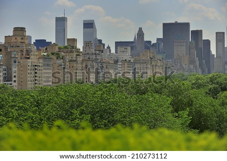 Trees in Central Park, New York City with skyscraper on 5th Avenue, New York, USA - stock photo