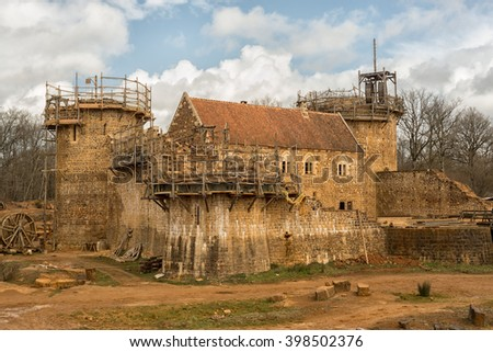 TREIGNY,FRANCE - MARCH 27 2016 : The future castle of Guedelon is an entirely new construction based on the  architectural canons of the 12th century. Begun in 1996, the project should end in 2025. - stock photo
