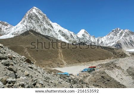 Trek at the foot of mount Everest (8848 m) near Gorak Shep village - Nepal, Himalayas - stock photo