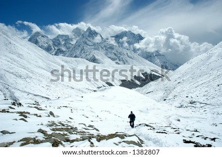 Trekker goes down in the Nepal Himalayas - stock photo