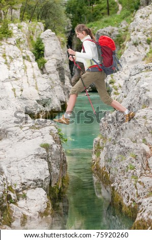 Trekking - girl on mountain trek - stock photo