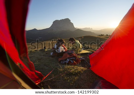 Trekking in the mountains - Camping in the Dolomite - base camp - stock photo