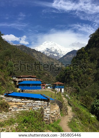 Trekking path to Everest, small village in the mountains, blue roof of rustic house in mountains, peaceful mountain landscape, summer mountain landscape with village, mountain village, Himalaya, Nepal - stock photo
