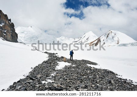 Trekking to Saribung Peak's high camp, Mustang, Nepal - stock photo