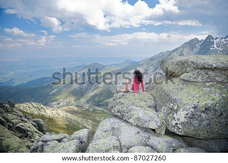 trekking woman at Gredos mountains in Avila Spain - stock photo