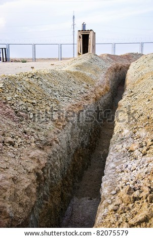 trench on industrial site - stock photo