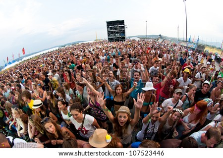 TRENCIN,SLOVAKIA - JULY 7: Crowd in front of the stage at the Bazant Pohoda Music Festival at the Trencin Airport in Trencin, Slovakia on July 7, 2012 - stock photo