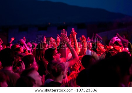 TRENCIN,SLOVAKIA - JULY 7: Crowd in front of the stage at the Bazant Pohoda Music Festival at the Trencin Airport in Trencin, Slovakia on July 7, 2012