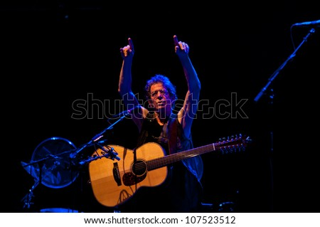 TRENCIN,SLOVAKIA - JULY 7:Lou Reed performs at the Pohoda Music Festival at the Trencin Airport in Trencin, Slovakia on July 7, 2012.